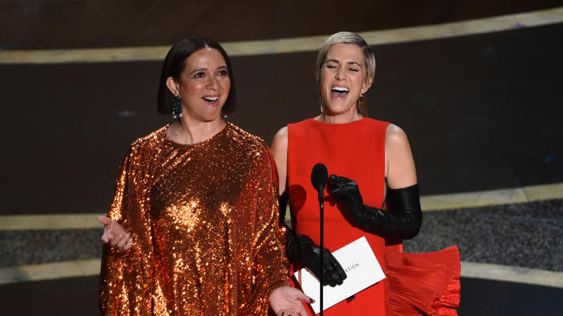 Maya Rudolph, left, and Kristen Wiig at the Oscars on Sunday, Feb. 9, 2020. (AP Photo/Chris Pizzello)