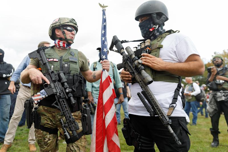 Heavily armed members of the far-right Proud Boys gang gather with their allies in Portland, Oregon, on Sept. 26. (Photo: Anadolu Agency via Getty Images)