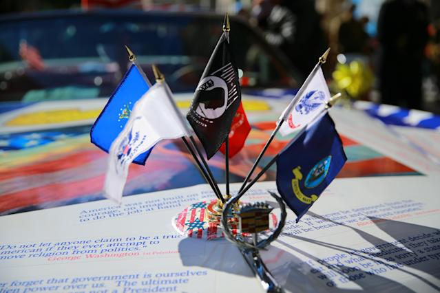 <p>Flags adorn an old Cadillac Eldorado convertible before the Veterans Day parade on Fifth Avenue in New York on Nov. 11, 2017. (Photo: Gordon Donovan/Yahoo News) </p>