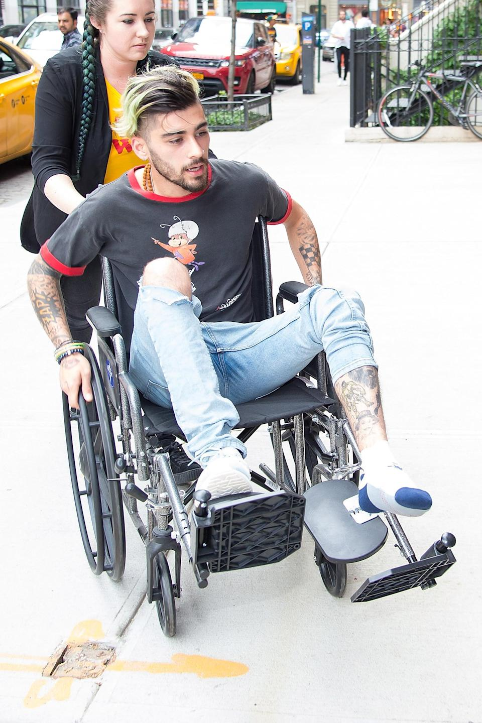 """<p>On Zayn Malik's left leg, he has a collection of comic book characters, including Deadpool and the Joker, as well as a wolf and feathers. He also has the name Rodger scrolled on his leg, which he <a href=""""https://twitter.com/zaynmalik/status/750756706335002624?lang=en"""" class=""""link rapid-noclick-resp"""" rel=""""nofollow noopener"""" target=""""_blank"""" data-ylk=""""slk:has joked is the name of his evil twin"""">has joked is the name of his evil twin</a>.</p>"""