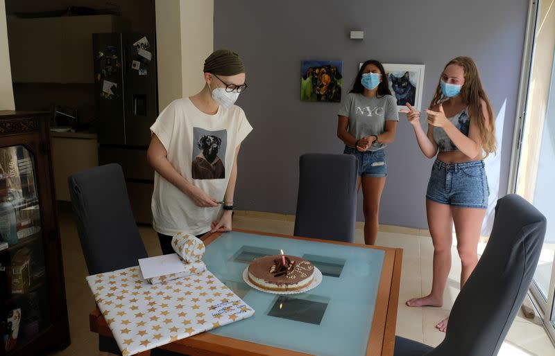 Wider Image: The pandemic, a deadly cancer and my 14-year-old daughter