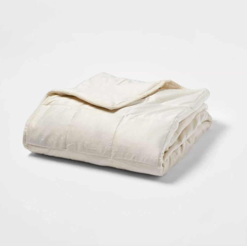 <p>This <span>Tranquility Weighted Blanket</span> ($49) is a useful gift for those experiencing stress and anxiety.</p>