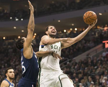 FILE PHOTO: Feb 23, 2019; Milwaukee, WI, USA; Milwaukee Bucks forward Nikola Mirotic (41) shoots during the first quarter against the Minnesota Timberwolves at Fiserv Forum. Mandatory Credit: Jeff Hanisch-USA TODAY Sports
