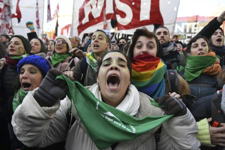 Abortion rights activists in Buenos Aires celebrate after the lower chamber of Argentina's Congress approved a bill legalizing abortion - a measure that still needs Senate approval to become law