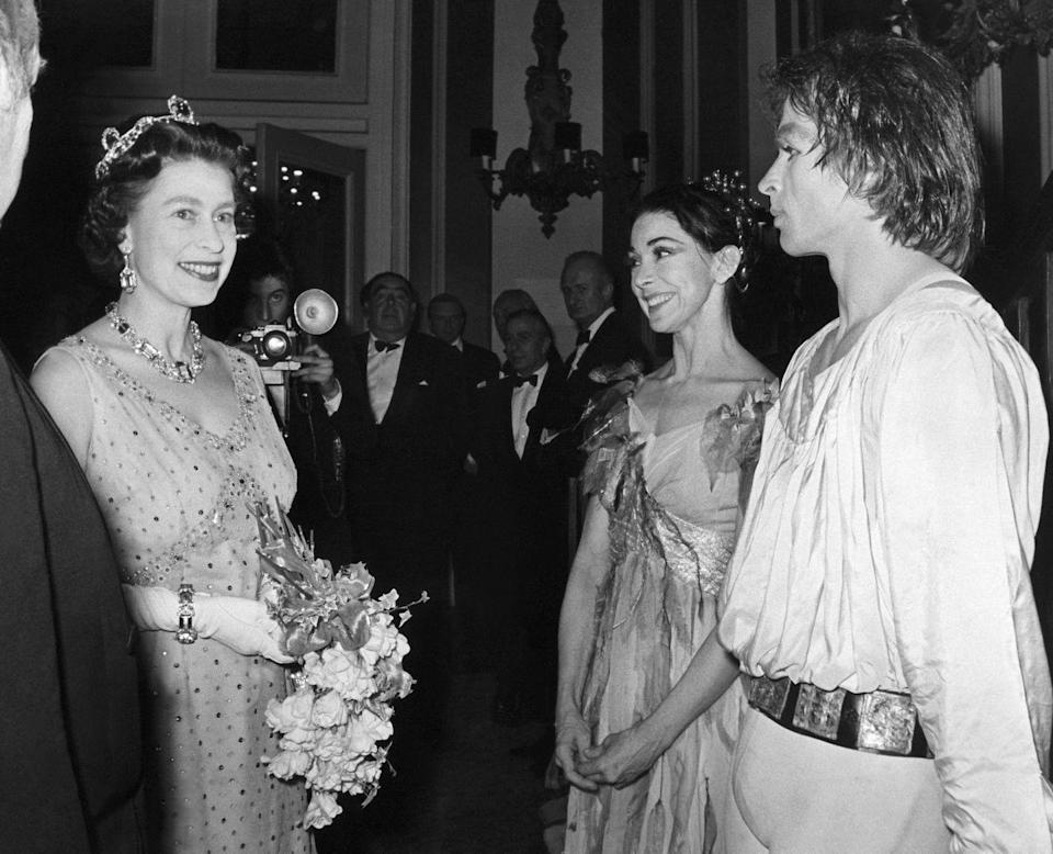 <p>A young Queen Elizabeth II appears here with Rudolph Nureyev and Dame Margot Fonteyn in 1969.</p>