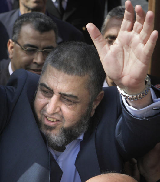 FILE - In this April 5, 2012 file photo, Egypt's Muslim Brotherhood candidate for presidency Khairat el-Shater waves to his supporters after he submitted his candidacy papers at the Higher Presidential Elections Commission, in Cairo, Egypt. The head of Egypt's elections commission says 10 presidential hopefuls, including ex-spy chief, key Islamists, were disqualified from the race. Farouk Sultan, the head of the Supreme Presidential Election Commission says Saturday ex-spy chief Omar Suleiman, Muslim Brotherhood chief strategist Khairat el-Shater, and a hardline lawyer-turned-preacher Hazem Abu Ismail have been excluded.(AP Photo/Amr Nabil, File)