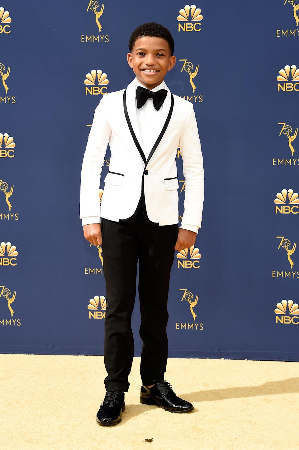 <p>The young <em>This Is Us</em> actor took a cue from his co-star Ventimiglia, wearing a white suit jacket with black detailing. (Photo: Getty Images) </p>
