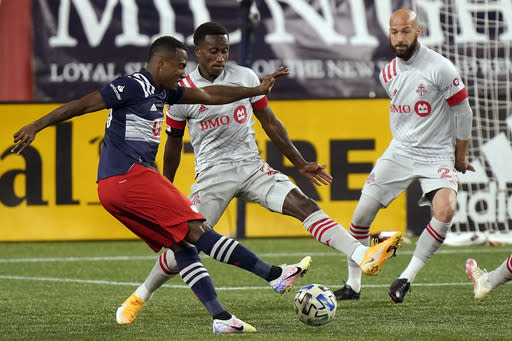 New England Revolution's Cristian Penilla, left, vies with Toronto FC's Richie Laryea, center, and Laurent Ciman, right, for the ball during the second half of an MLS soccer match, Wednesday, Oct. 7, 2020, in Foxborough, Mass. Toronto FC won 1-0. (AP Photo/Steven Senne)