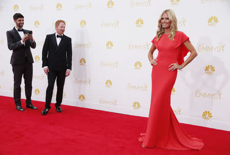 Justin Mikita, Jesse Tyler Ferguson and Heidi Klum arrive at the 66th Primetime Emmy Awards in Los Angeles