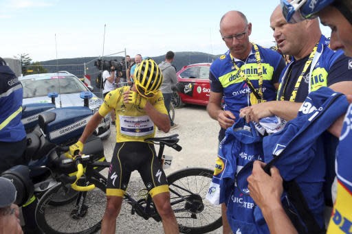 France's Julian Alaphilippe wearing the overall leader's yellow jersey reacts after he crossed the finish line of the sixth stage of the Tour de France cycling race over 160 kilometers (100 miles) with start in Mulhouse and finish in La Planche des Belles Filles, France, Thursday, July 11, 2019. (AP Photo/Thibault Camus)