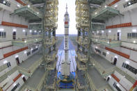 In this photo released by Xinhua News Agency, the Shenzhou-13 manned spaceship onto of a Long March-2F carrier rocket prepares to be transferred to the launching area of Jiuquan Satellite Launch Center in northwestern China, Oct. 7, 2021. China is preparing to send three astronauts to live on its space station for six months — a new milestone for a program that has advanced rapidly in recent years. (Wang Jiangbo/Xinhua via AP)