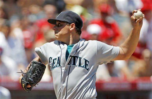 Seattle Mariners starter Jason Vargas pitches to the Los Angeles Angeles Angels in the second inning of a baseball game in Anaheim, Calif., Sunday, Aug. 12, 2012. (AP Photo/Reed Saxon)