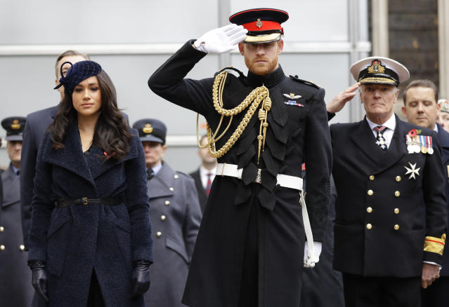 Prince Harry and Meghan Markle pay their respects during a Remembrance Day event earlier this month. [Photo: Getty]