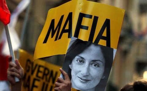 Protests over the murder of Daphne Caruana Galizia cost Joseph Muscat his job - Credit: Reuters