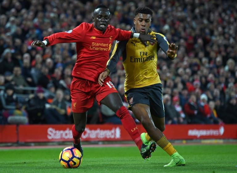 Liverpool's midfielder Sadio Mane (L) vies with Arsenal's striker Alex Iwobi during the English Premier League football match March 4, 2017