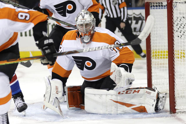 Philadelphia Flyers goaltender Carter Hart itches the puck during the second period of the NHL hockey game against the New York Rangers, Sunday, March 1, 2020, in New York. (AP Photo/Seth Wenig)