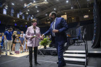 Duke University basketball coach Mike Krzyzewski holds his wife Mickie Krzyzewski's hand as he walks off stage after following an NCAA college basketball news conference Thursday, June 3, 2021, at Cameron Indoor Stadium in Durham, N.C. Krzyzewski, the winningest coach in the history of Division I men's college basketball announced that next season will be his last with the Blue Devils program he has built into one of college basketball's bluebloods. The school named former Duke player and associate head coach Jon Scheyer as his successor for the 2022-23 season. (Travis Long/The News & Observer via AP)