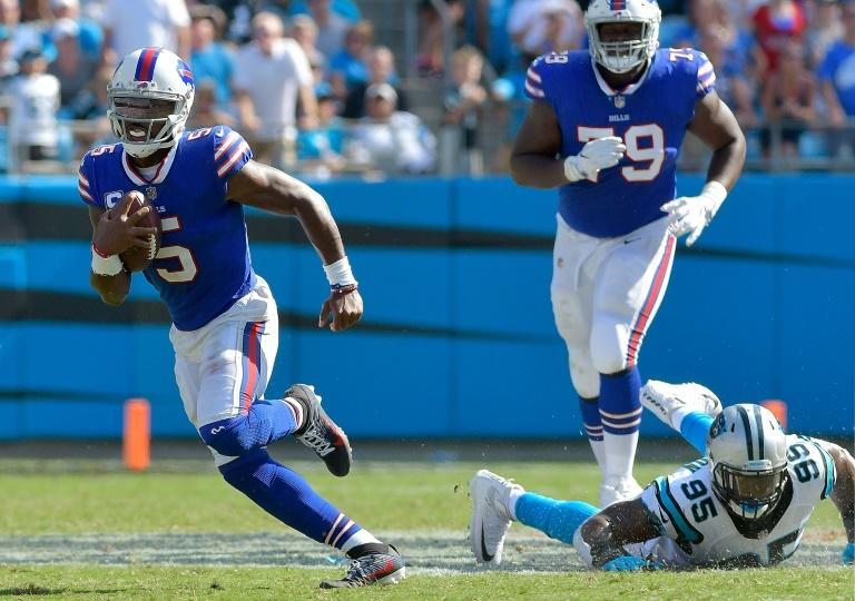 Tyrod Taylor of the Buffalo Bills scrambles against the Carolina Panthers during their game at Bank of America Stadium in Charlotte, North Carolina, on September 17, 2017