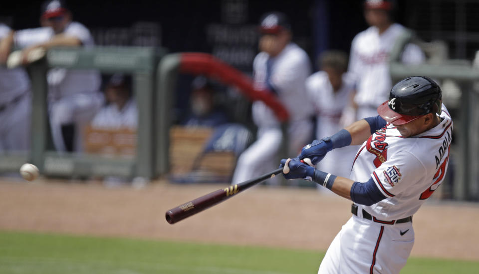Atlanta Braves' Ehire Adrianza swings for an RBI single off Toronto Blue Jays' Ross Stripling in the first inning of a baseball game Thursday, May 13, 2021, in Atlanta. (AP Photo/Ben Margot)