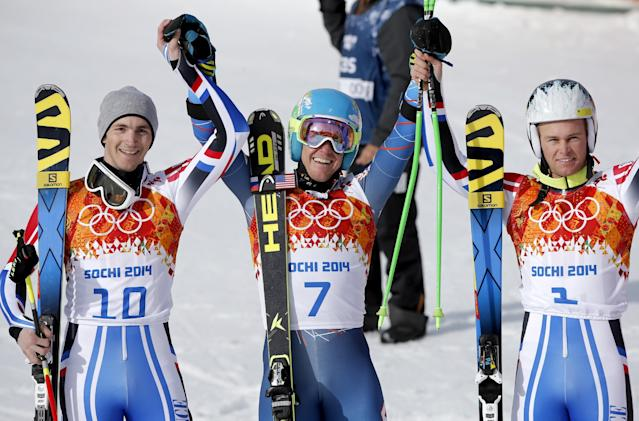 Men's giant slalom winners, from left, France's Steve Missillier (silver), United States' Ted Ligety (gold) and France's Alexis Pinturault (bronze) pose for photographers at the Sochi 2014 Winter Olympics, Wednesday, Feb. 19, 2014, in Krasnaya Polyana, Russia. (AP Photo/Christophe Ena)