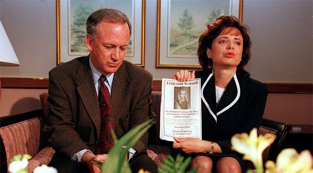 John and Patsy Ramsay hold up a flyer promising a $100,000 reward for information in 1997. Photo: Getty Images