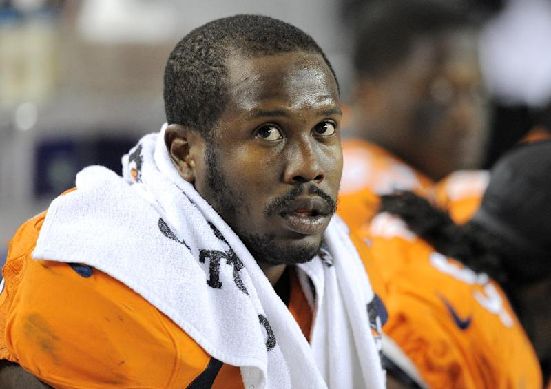 FILe - In this Dec. .2, 2012 file photo, Denver Broncos outside linebacker Von Miller looks on from the bench during an NFL football game against the Tampa Bay Buccaneers in Denver. A person with knowledge of the situation says Pro Bowl linebacker Von Miller will miss the first month of the season for violating the NFL's drug policy, pending an appeal. The person spoke to The Associated Press on condition of anonymity because the league hasn't announced any punishment. (AP Photo/Jack Dempsey, File)
