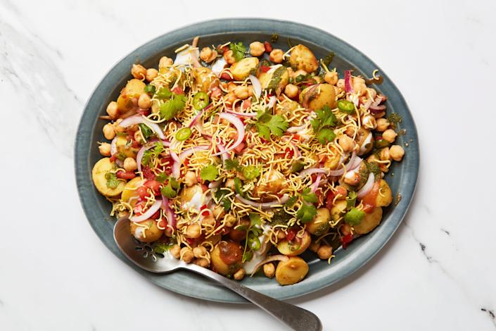 """This is the perfect summer move: Boil your potatoes in the morning, prep your chutneys in advance, and then this meal is a simple assembly situation. Every bite has the ideal combination of crunchy and creamy, sweet, tangy, and spicy. <a href=""""https://www.epicurious.com/recipes/food/views/chickpea-potato-chaat?mbid=synd_yahoo_rss"""" rel=""""nofollow noopener"""" target=""""_blank"""" data-ylk=""""slk:See recipe."""" class=""""link rapid-noclick-resp"""">See recipe.</a>"""