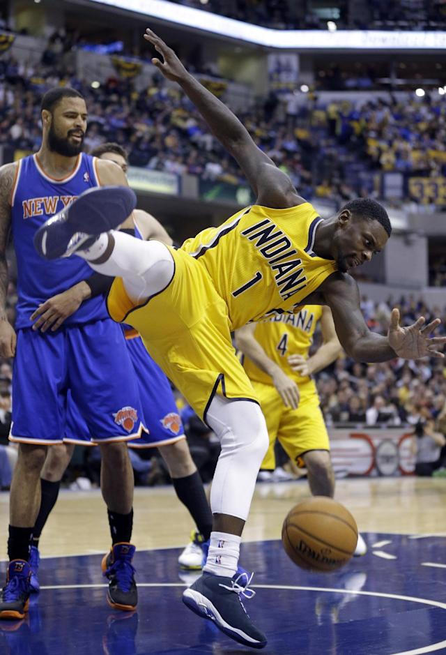 Indiana Pacers guard Lance Stephenson (1) comes down after being fouled by New York Knicks center Tyson Chandler on a shot during the second half of an NBA basketball game in Indianapolis, Thursday, Jan. 16, 2014. The Pacers defeated the Knicks 117-89. (AP Photo/Michael Conroy)