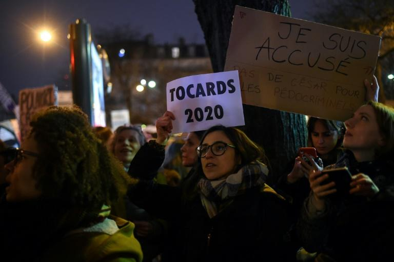 Feminist activists outside the Cesars award ceremony in Paris (AFP Photo/Lucas BARIOULET)