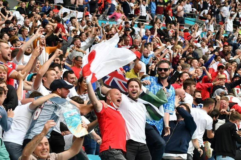 England supporters celebrate their team's win over Germany at Wembley