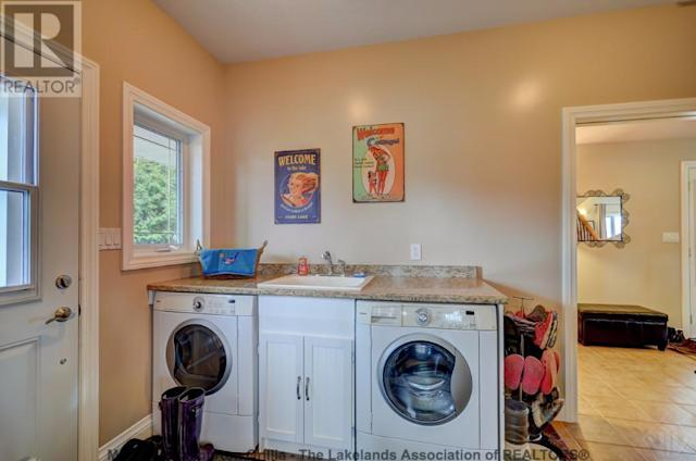 <p><span>359 Falcon Road, Huntsville, Ont.</span><br> The laundry room is conveniently on the main level, to help quickly clean up after outdoor adventures.<br> (Photo: Zoocasa) </p>