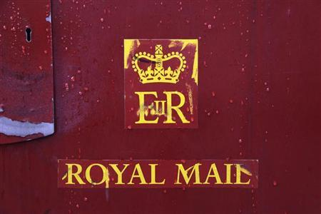 Raindrops are seen on a Royal Mail post box in central London