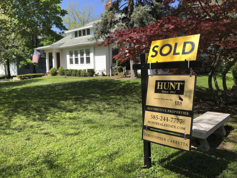This May 22, 2020 photo shows a sold sign in front of a house in Brighton, N.Y.  On Thursday, May 28, long-term U.S. mortgage rates fell this week as the key 30-year home loan marked an all-time low for the third time in the last few months since the coronavirus outbreak took hold. Mortgage buyer Freddie Mac reports that the average rate on the 30-year loan tumbled to 3.15% from 3.24% last week. (AP Photo/Ted Shaffrey)