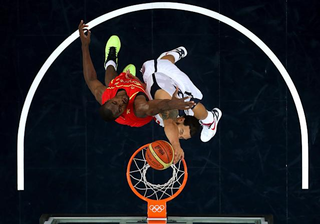 LONDON, ENGLAND - AUGUST 12: Deron Williams #8 of the United States dunks over Serge Ibaka #14 of Spain during the Men's Basketball gold medal game between the United States and Spain on Day 16 of the London 2012 Olympics Games at North Greenwich Arena on August 12, 2012 in London, England. (Photo by Christian Petersen/Getty Images)