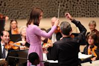 <p><b><b><b>Kate tries her hand at conducting the orchestra during a visit to the Elbphilharmonie Concert Hall. <br><em>[Photo: PA]</em> </b></b></b></p>