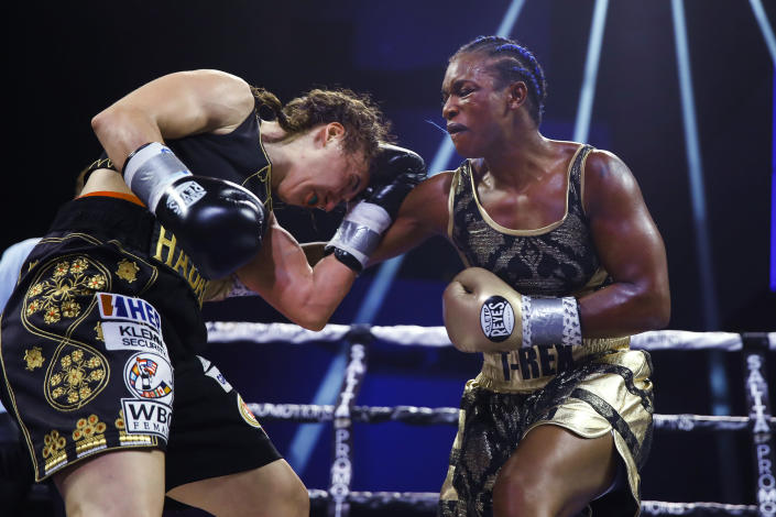 FILE - In this Jan. 10, 2020, file photo, Claressa Shields, right, punches Ivana Habazin during the seventh round of a women's 154-pound title boxing bout in Atlantic City, N.J. Shields is already dominating the boxing world with two Olympic gold medals and professional title belts in three weight classes. Her next world to conquer is mixed martial arts. Shields has signed with the Professional Fighters League to begin her quest to become the most accomplished women's combat sports athlete in history. (AP Photo/Matt Rourke, File)