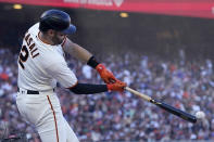 San Francisco Giants' Curt Casali hits an RBI-single against the Los Angeles Dodgers during the third inning of a baseball game in San Francisco, Sunday, Sept. 5, 2021. (AP Photo/Jeff Chiu)
