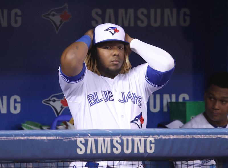 TORONTO, ON - MAY 20: Vladimir Guerrero Jr. #27 of the Toronto Blue Jays looks on from the dugout during MLB game action against the Boston Red Sox at Rogers Centre on May 20, 2019 in Toronto, Canada. (Photo by Tom Szczerbowski/Getty Images)