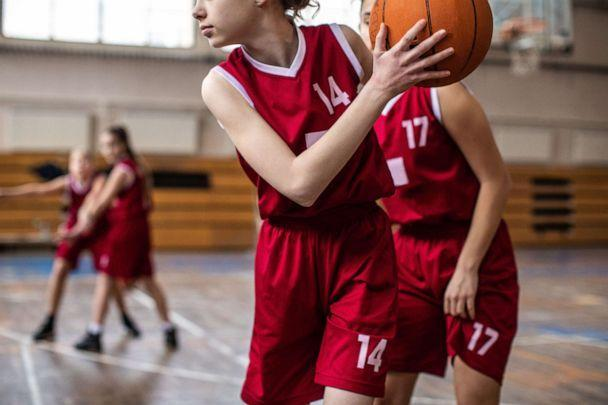 PHOTO: Young women play basketball in this stock photo. (STOCK PHOTO/Getty Images)