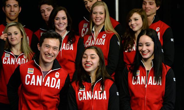 Figure skaters, bottom rowfrom left to right, Patrick Chan, Gabrielle Daleman and Kaetlyn Osmond are joined by teammates during the announcement of the Canadian Olympic Team in Ottawa, Ontario, Sunday, Jan. 12, 2014. The skaters are to represent Canada in Sochi. (AP Photo/The Canadian Press, Sean Kilpatrick)