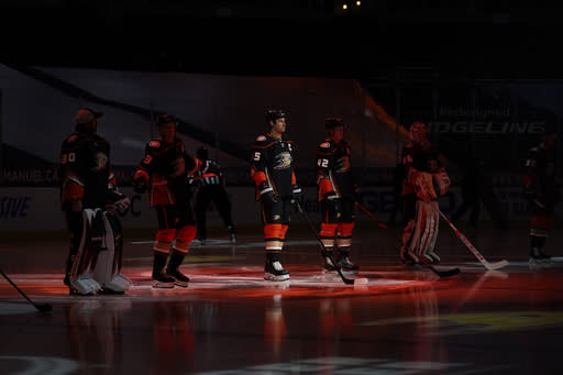 The Anaheim Ducks are introduced before an NHL hockey game against the Minnesota Wild Monday, Jan. 18, 2021, in Anaheim, Calif. (AP Photo/Marcio Jose Sanchez)