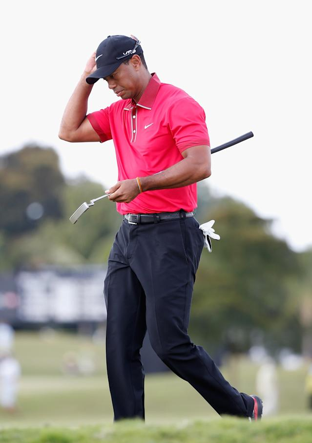 DORAL, FL - MARCH 09: Tiger Woods walks off a green during the final round of the World Golf Championships-Cadillac Championship at Trump National Doral on March 9, 2014 in Doral, Florida. (Photo by Chris Trotman/Getty Images)