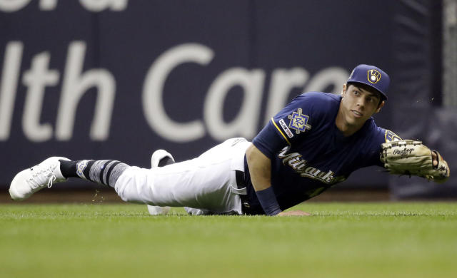 Milwaukee Brewers' Christian Yelich makes a diving catch on a ball hit by St. Louis Cardinals' Kolten Wong during the seventh inning of a baseball game Monday, April 15, 2019, in Milwaukee. (AP Photo/Jeffrey Phelps)