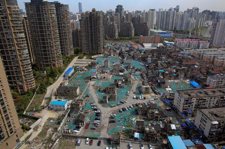 FILE PHOTO: A view of old houses surrounded by new apartment buildings in Guangfuli neighbourhood in Shanghai