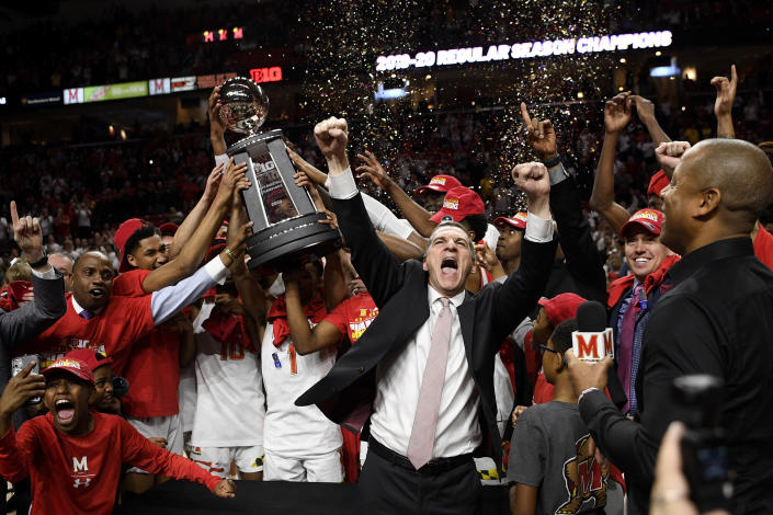Maryland head coach Mark Turgeon, right center, and his team celebrate after they won a share of the Big Ten regular season title after defeating Michigan in an NCAA college basketball game, Sunday, March 8, 2020, in College Park, Md. (AP Photo/Nick Wass)