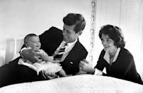 <p>JFK and Jackie relax at home with their first child, Caroline. </p>