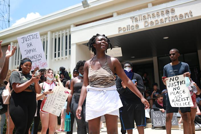Oluwatoyin Salau, 19, protests in front of the Tallahassee Police Department on May 30. Salau went missing June 6 and was found dead June 13.