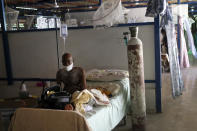 A COVID-19 patient rests on the bed in the intensive care unit of Saint Luke Foundation for Haiti Hospital in Port-au-Prince, Haiti, Saturday, July 17, 2021, amid the new coronavirus pandemic. (AP Photo/Matias Delacroix)