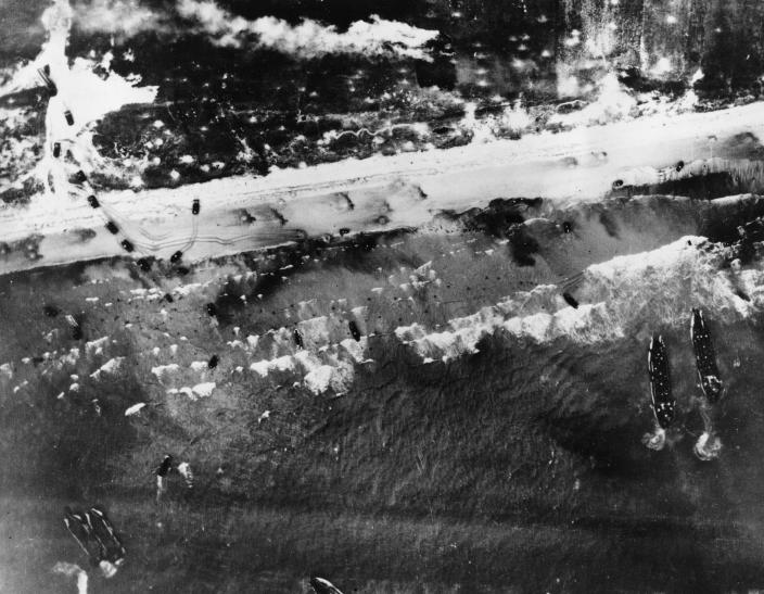 Men and assault vehicles storm the beach as Allied landing crafts reach their destination during the initial Normandy landing operations in France on June 6, 1944. (Photo: AP)