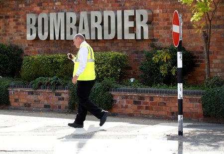 FILE PHOTO: A worker walks past the entrance to the Bombardier plant in Derby, central England, July 5, 2011.    REUTERS/Darren Staples/File Photo